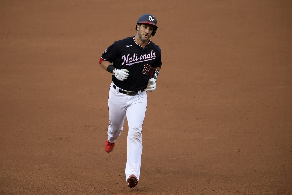 Washington Nationals' Yan Gomes rounds the bases after hitting a home run during the second inning of a baseball game against the Miami Marlins, Frida...