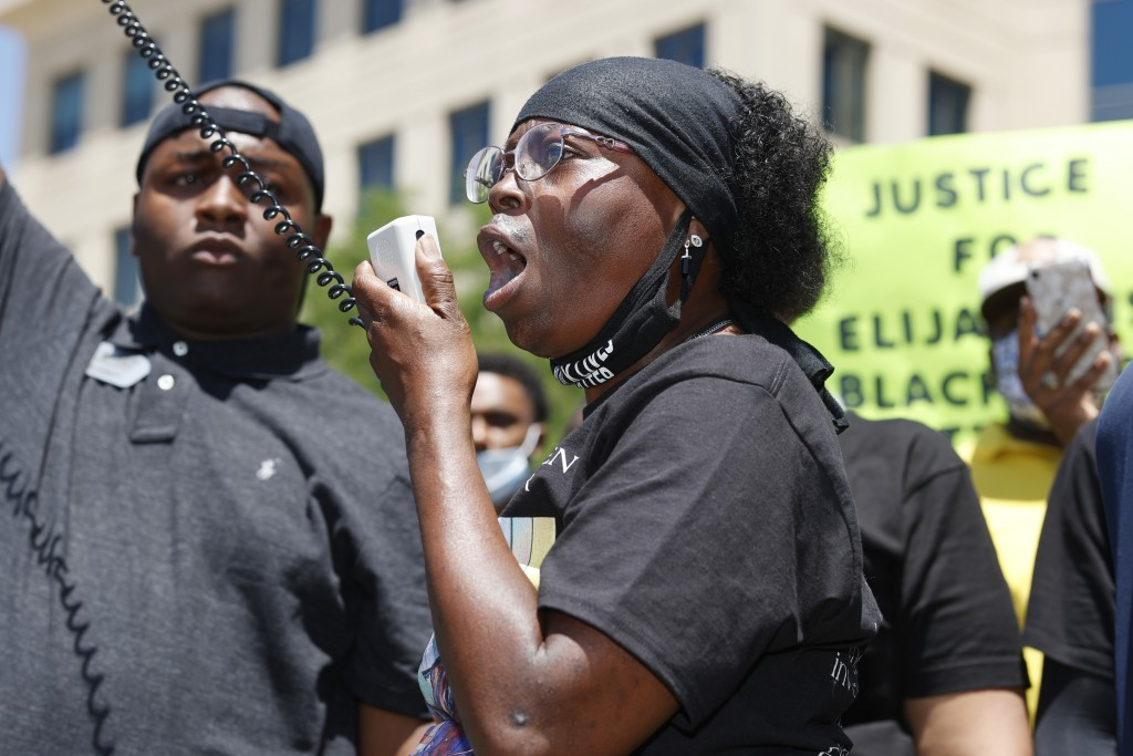 FILE - In this June 27, 2020, file photo, Sheneen McClain speaks during a rally and march over the death of her 23-year-old son Elijah McClain, outsid...