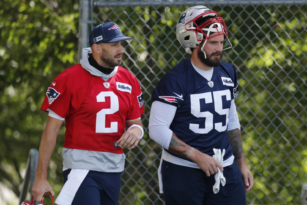 New England Patriots quarterback Brian Hoyer (2) and defensive end John Simon (55) during an NFL football training camp practice, Friday, Aug. 21, 202...