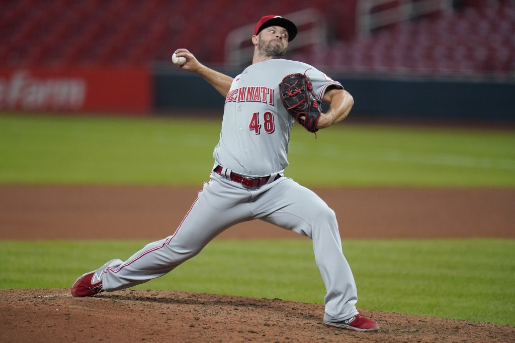 Cincinnati Reds relief pitcher Tyler Thornburg throws during the seventh inning of a baseball game against the St. Louis Cardinals Friday, Aug. 21, 20...