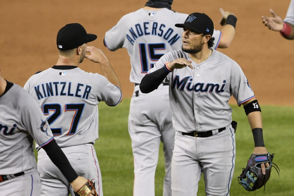 Miami Marlins' Miguel Rojas, right, and Brandon Kintzler (27) celebrate after a baseball game against the Washington Nationals, Friday, Aug. 21, 2020,...