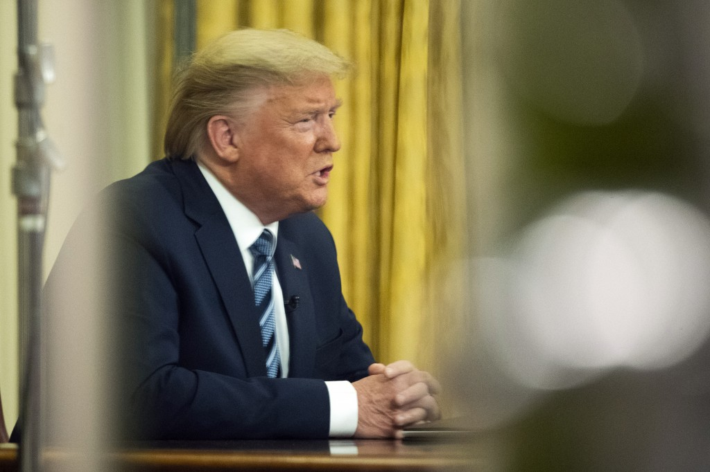 FILE - In this March 11, 2020, file photo President Donald Trump addresses the nation from the Oval Office at the White House in Washington. For only ...
