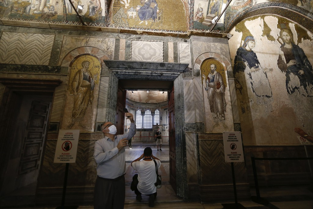 People visit St Savior in Chora church, known as Kariye in Turkish, in Istanbul, Friday, Aug. 21, 2020. Turkey on Friday formally converted former Byz...