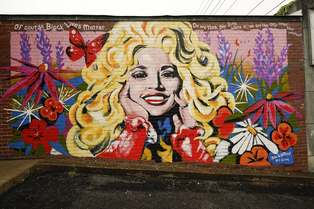 A mural of Dolly Parton is seen outside The 5 Spot, a music club in Nashville, Tenn., Friday, Aug. 21, 2020. Artist Kim Radford said Dolly fans from a...