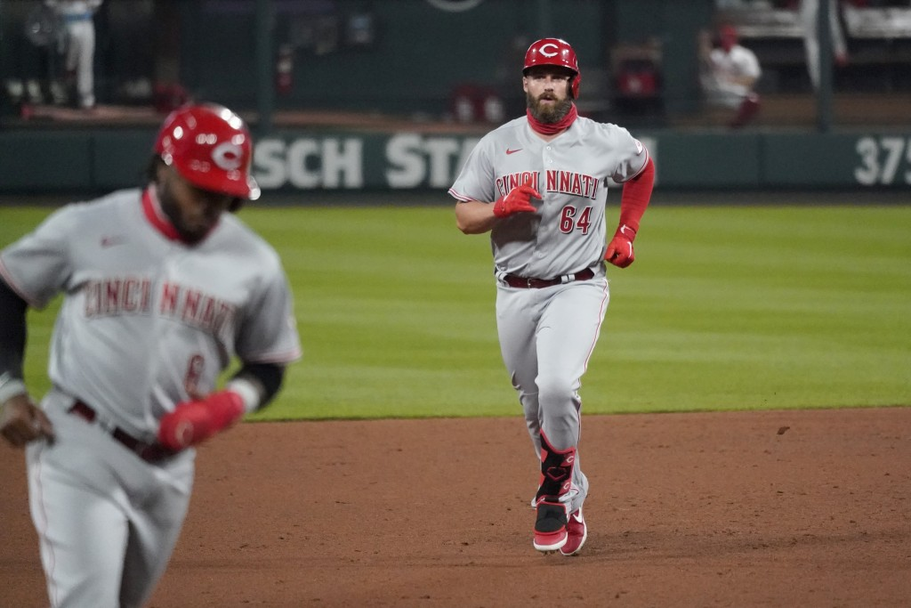 Cincinnati Reds' Matt Davidson (64) rounds the bases after hitting a grand slam during the sixth inning of a baseball game against the St. Louis Cardi...