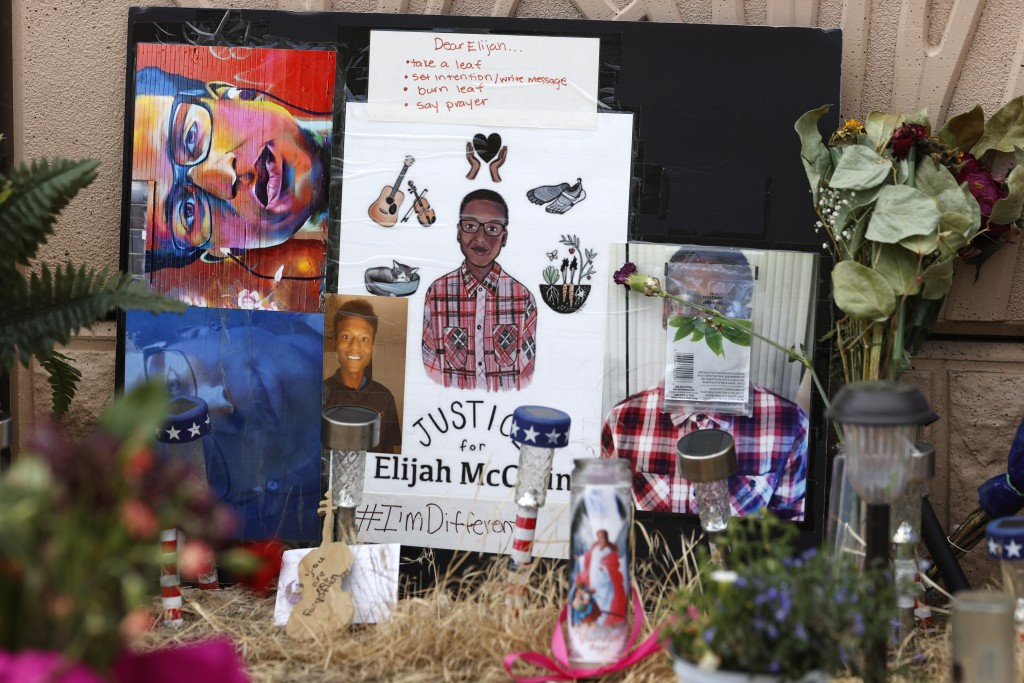 FILE - In this July 3, 2020, file photo, a makeshift memorial stands at a site across the street from where Elijah McClain was stopped by police offic...