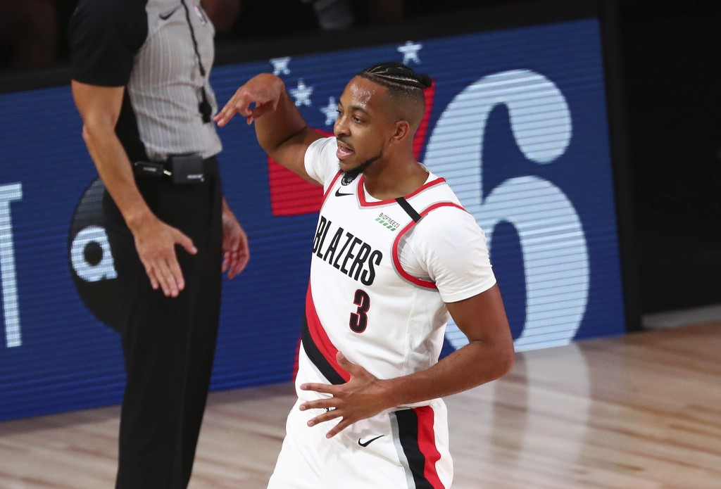 Portland Trail Blazers guard CJ McCollum (3) celebrates after scoring a 3-pointer against the Los Angeles Lakers during the first half of Game 3 of an...