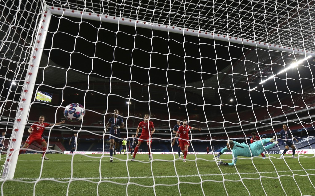 PSG's goalkeeper Keylor Navas fails to make a save on a shot taken by Bayern's Kingsley Coman, 2nd right, during the Champions League final soccer mat...