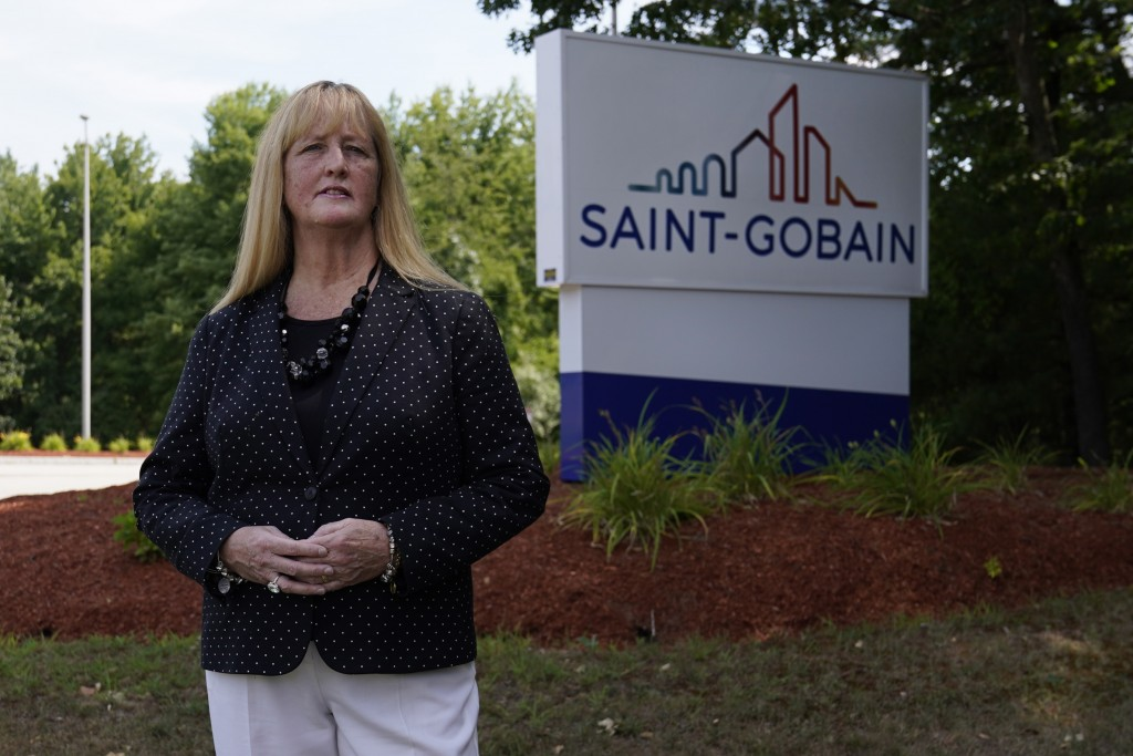 In this Friday, Aug. 14, 2020, photo New Hampshire Rep. Nancy Murphy, D-Merrimack, poses for a photo outside the Saint-Gobain plastics factory in Merr...