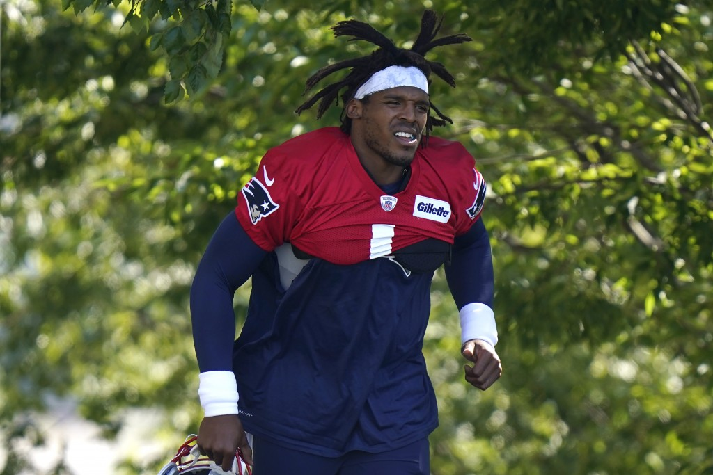New England Patriots quarterback Cam Newton steps on the field during an NFL football training camp practice, Sunday, Aug. 23, 2020, in Foxborough, Ma...