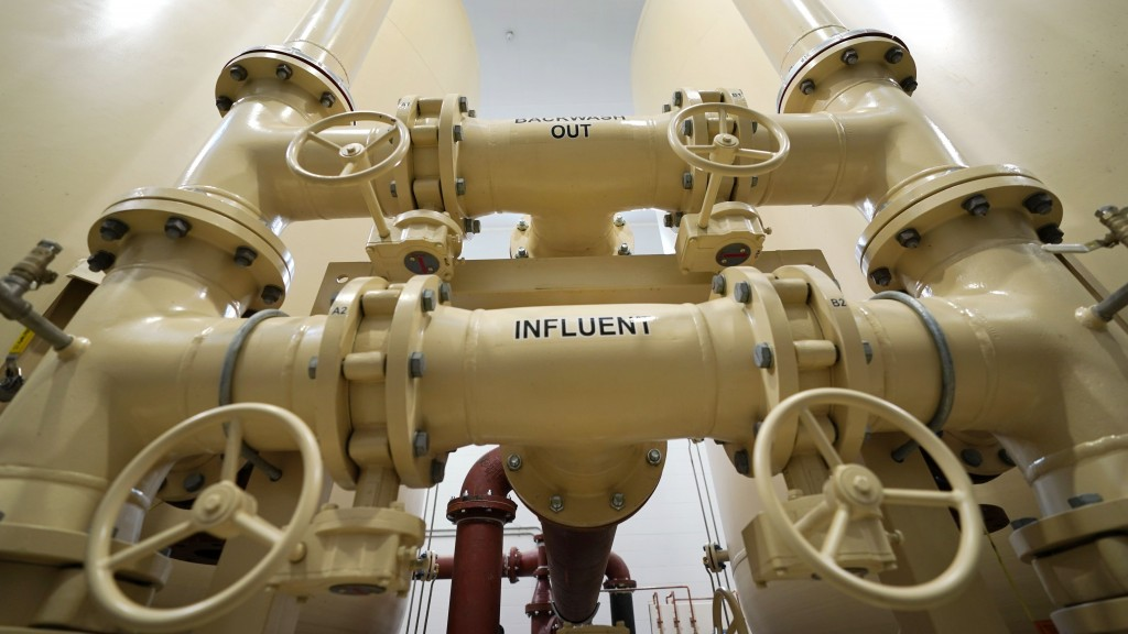 In this Friday, Aug. 14, 2020, photo valves and piping are labeled backwash out and influent in Merrimack, N.H., in an under-construction town water f...