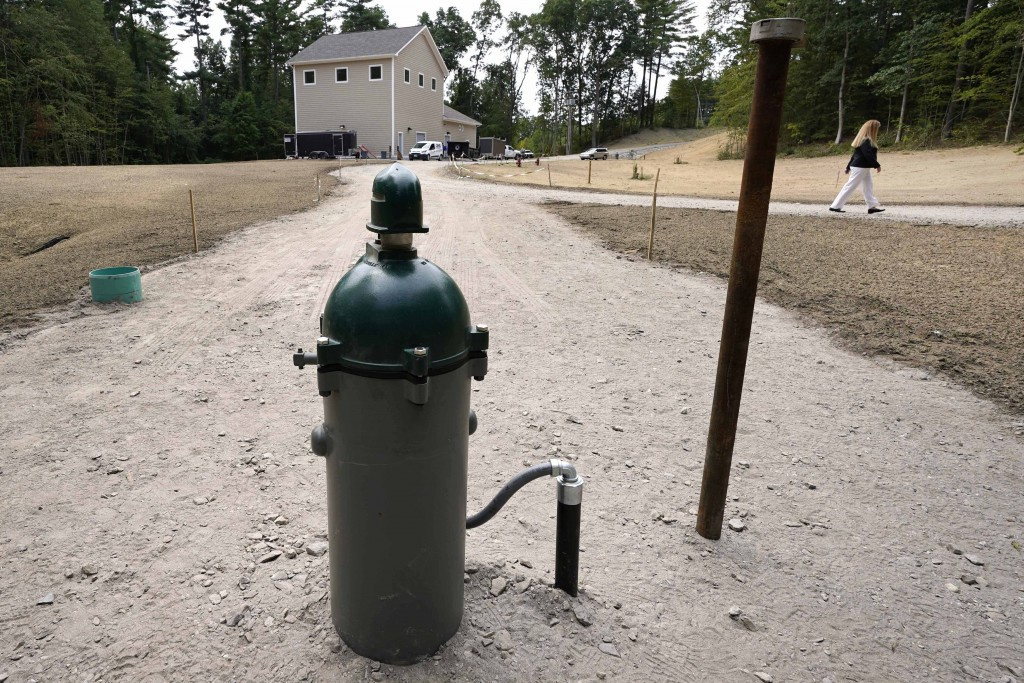 In this Friday, Aug. 14, 2020, photo New Hampshire Rep. Nancy Murphy, D-Merrimack, walks through the under-construction water filtration site for two ...