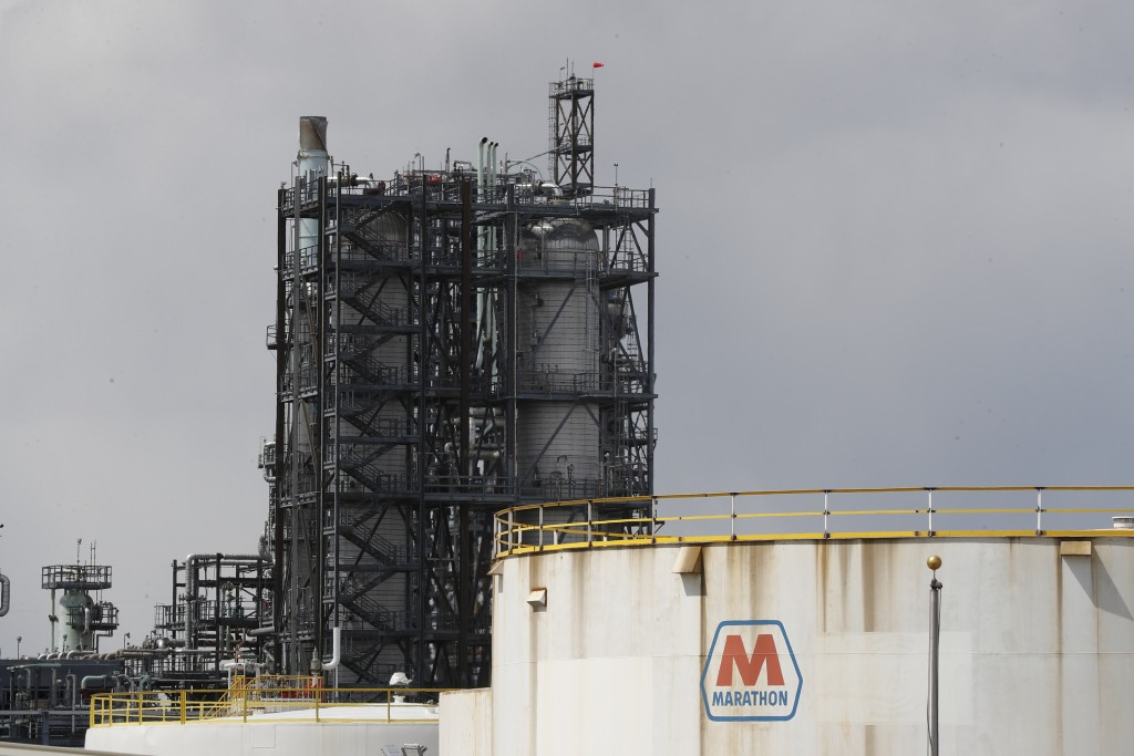 FILE - In this April 21, 2020, file photo storage is shown at the Marathon Petroleum Corp. refinery in Detroit. Thousands of oil and gas operations, g...