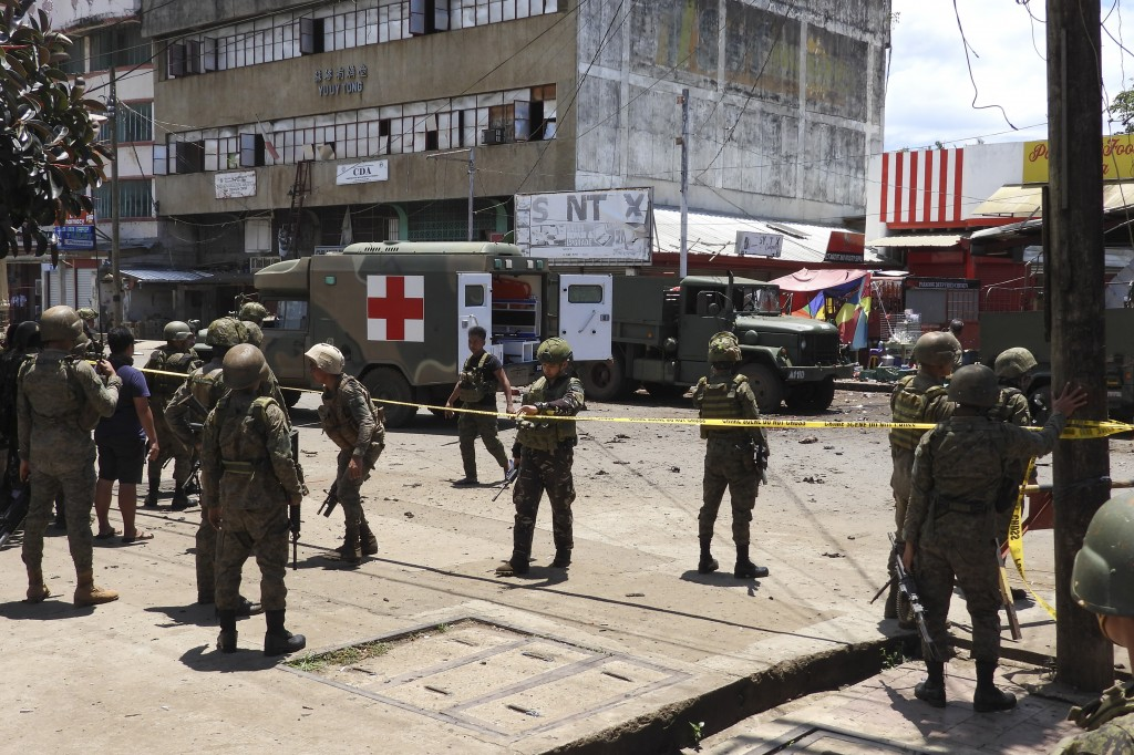 Police and military secure the site of an explosion in the town of Jolo, Sulu province southern Philippines on Monday Aug. 24, 2020. Bombs exploded in...