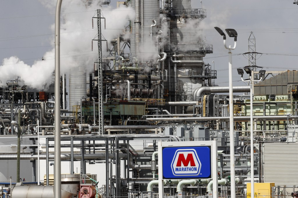 FILE - In this April 21, 2020, file photo the Marathon Petroleum Corp. refinery is shown in Detroit. Thousands of oil and gas operations, government f...