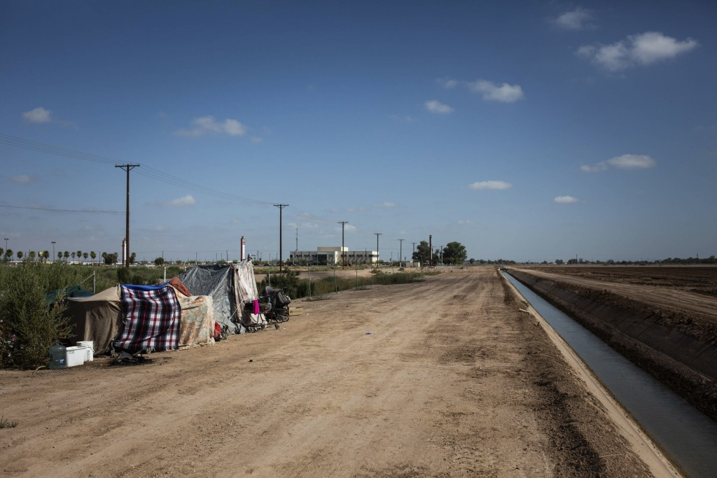 This July 24, 2020, photo shows a homeless encampment near a canal in El Centro, Calif. As support services have dwindled amid the COVID-19 pandemic, ...