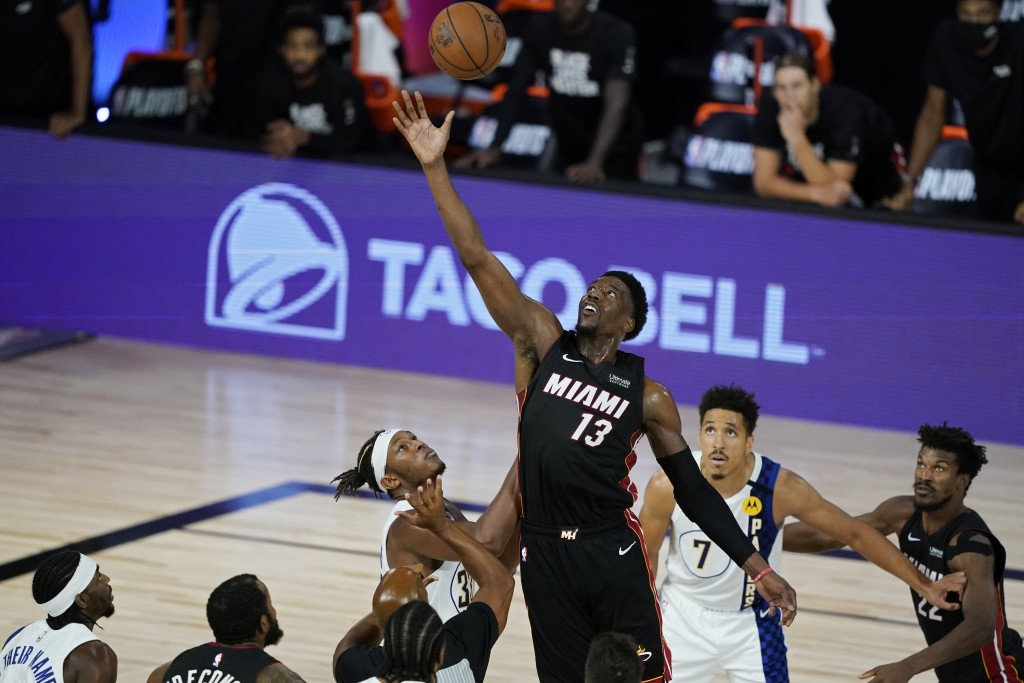 Miami Heat's Bam Adebayo (13) grabs the ball over the Indiana Pacers during the second half of an NBA basketball first round playoff game Monday, Aug....