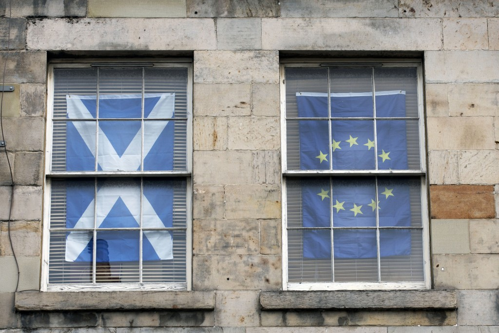 A Scottish Saltire flag hangs in the window of an apartment near the Royal Mile in Edinburgh, Scotland, Friday, Aug, 21, 2020. The handling of the cor...