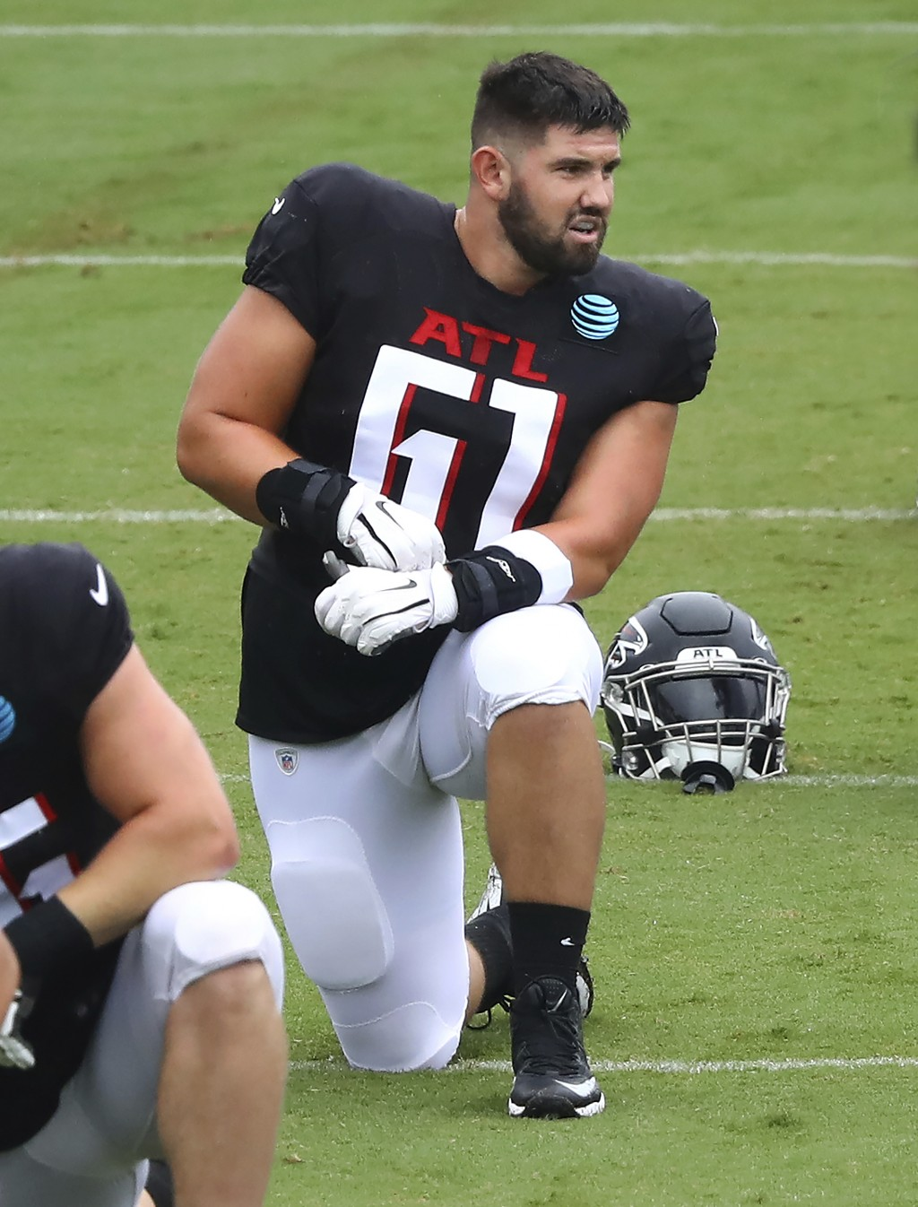 Atlanta Falcons rookie center Matt Hennessy loosens up during an NFL football training camp practice in Flowery Branch, Ga., Monday, Aug. 24, 2020.  (...