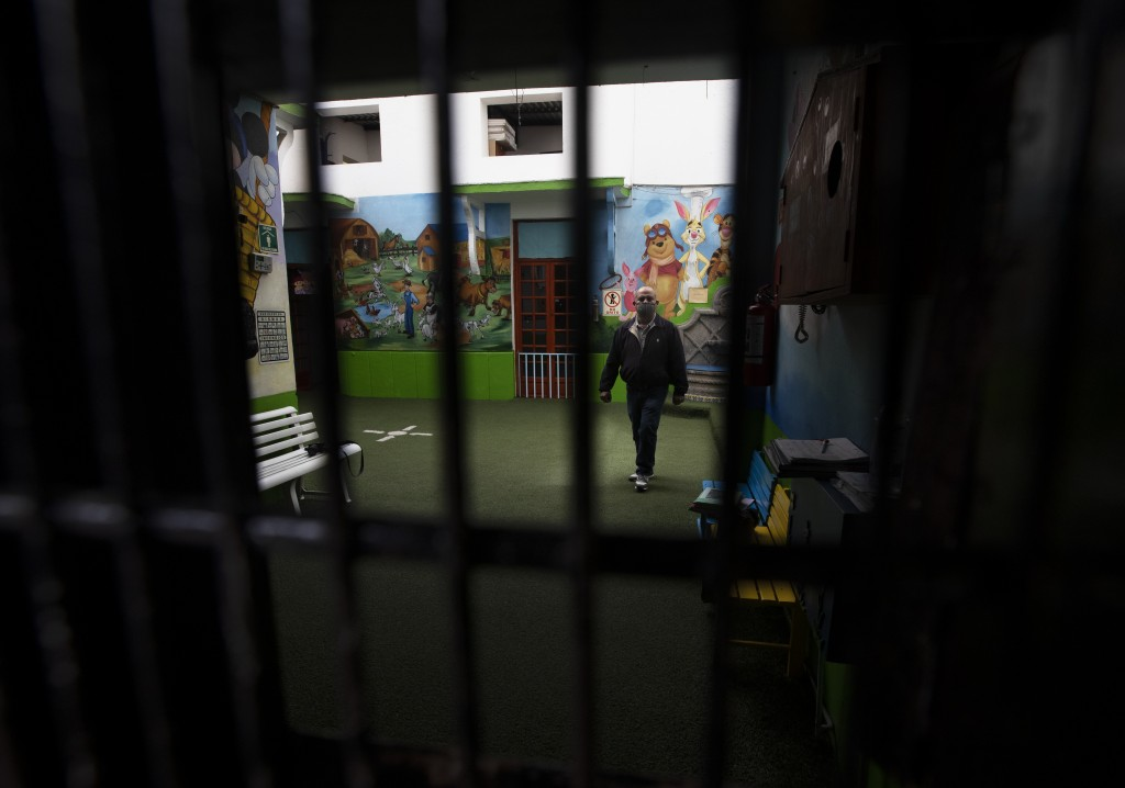 School employee Joel Barbas walk inside the empty Benito Juarez school amid the new coronavirus pandemic, as students return to classes but not school...