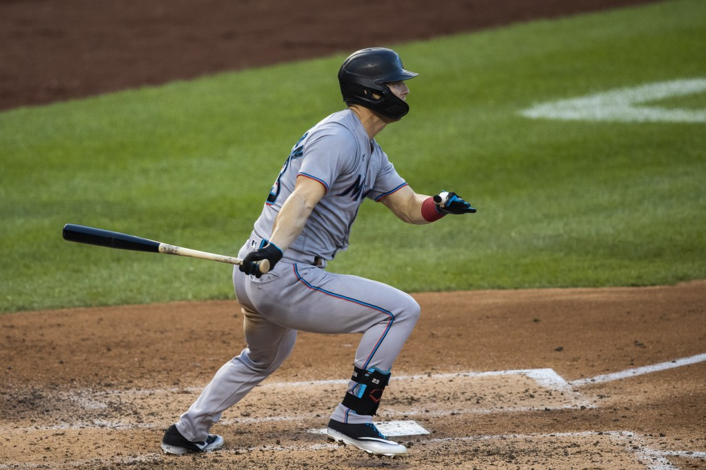 Miami Marlins Corey Dickerson hits a one-run single during the fourth inning of a baseball game against the Washington Nationals in Washington, Monday...