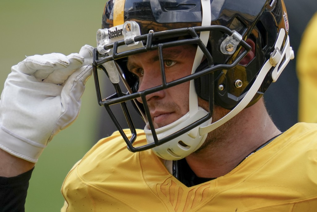 Pittsburgh Steelers linebacker T.J. Watt (90) grabs his mouth guard before going through a drill during an NFL football training camp practice, Monday...
