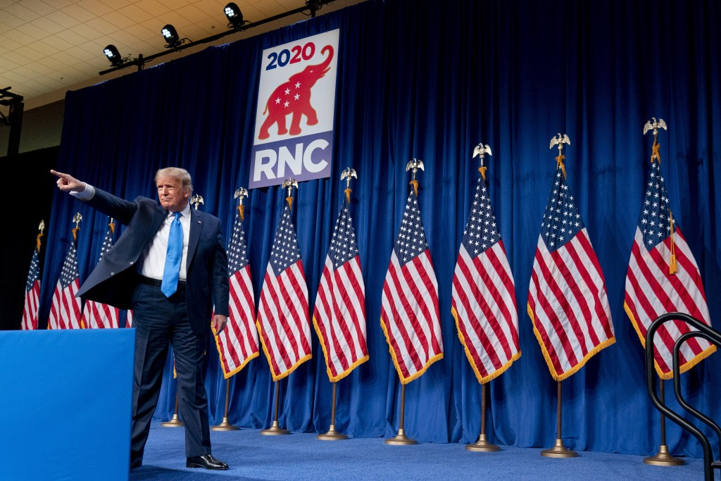 President Donald Trump points out into the audience after speaking during the first day of the 2020 Republican National Convention in Charlotte, N.C.,...