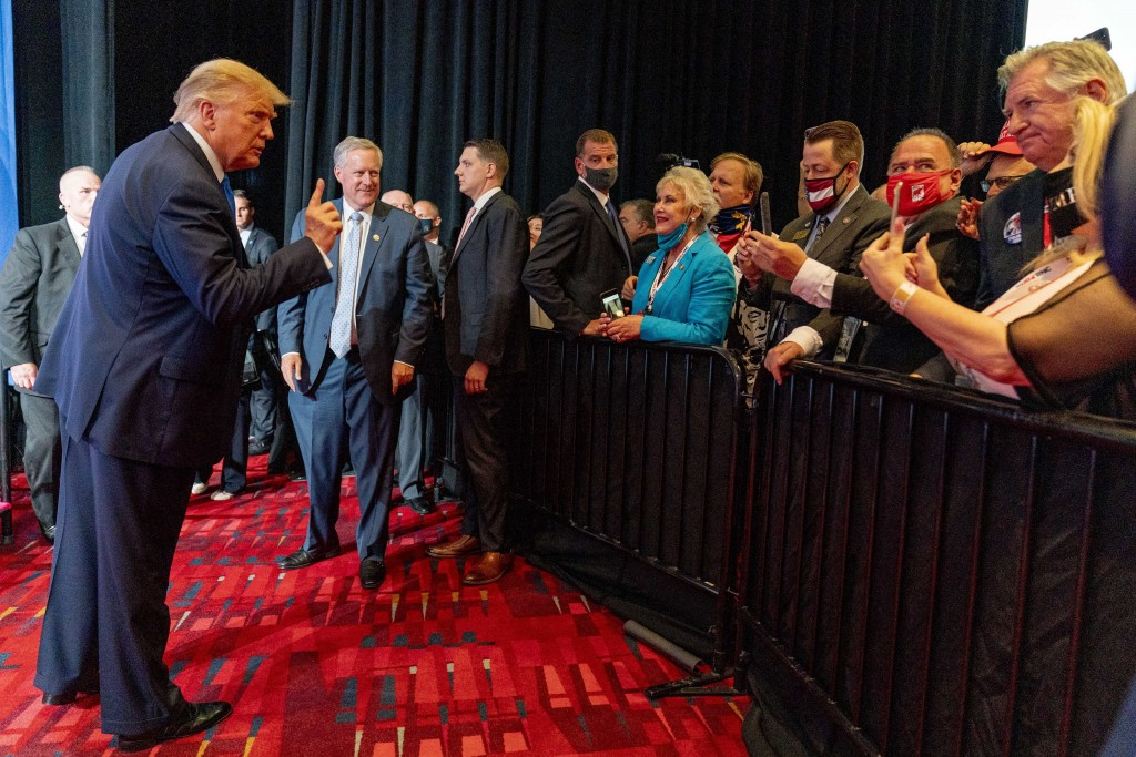 President Donald Trump points to member of the audience after speaking during the first day of the 2020 Republican National Convention in Charlotte, N...