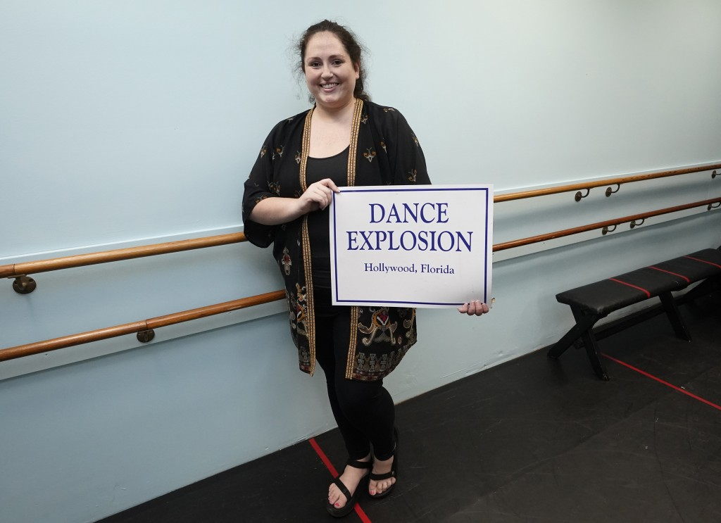 Katie Goughan, owner of Dance Explosion Co. studio, poses for a photo at her studio, Thursday, Aug. 13, 2020, in Hollywood, Fla. Her studio has hired ...