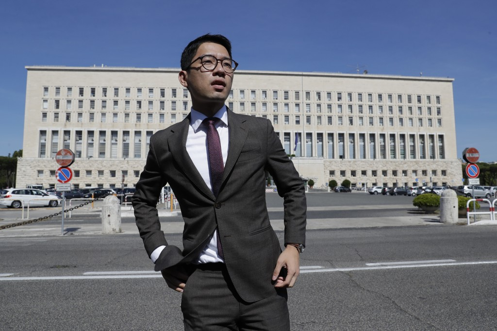Hong Kong activist Nathan Law takes part in a protest during a meeting of Chinese Foreign Minister Wang Yi with Italian Foreign Minister Luigi Di Maio...