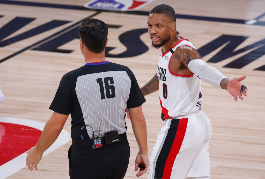Portland Trail Blazers' Damian Lillard (0) argues with referee David Guthrie (16) during the first quarter of Game 4 of an NBA basketball first-round ...