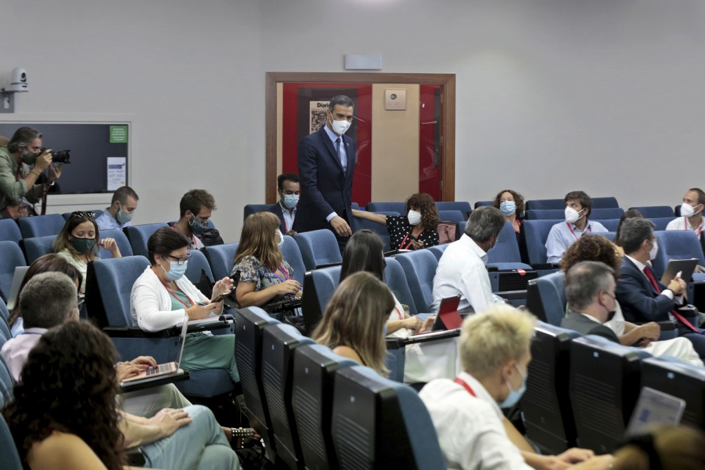 In this photo taken and provided by the Spanish Government on Tuesday Aug. 25, 2020, Spain's Prime Minister Pedro Sanchez arrives to give a news confe...