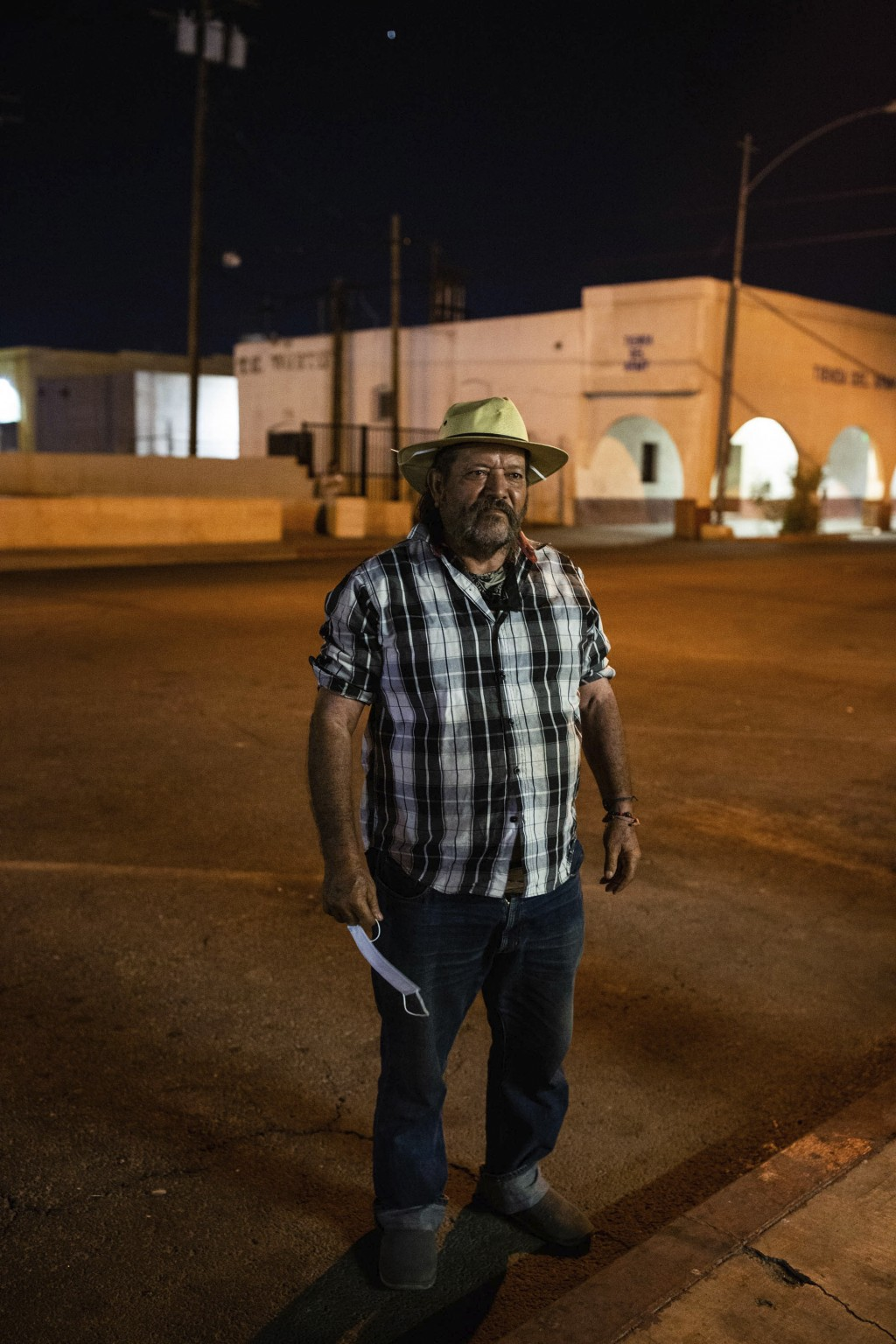Sergio Gomes Macias stands on street in Calexico, Calif., on July 23, 2020. Macias is a farmworker who sleeps on the street about 500 feet from the Me...