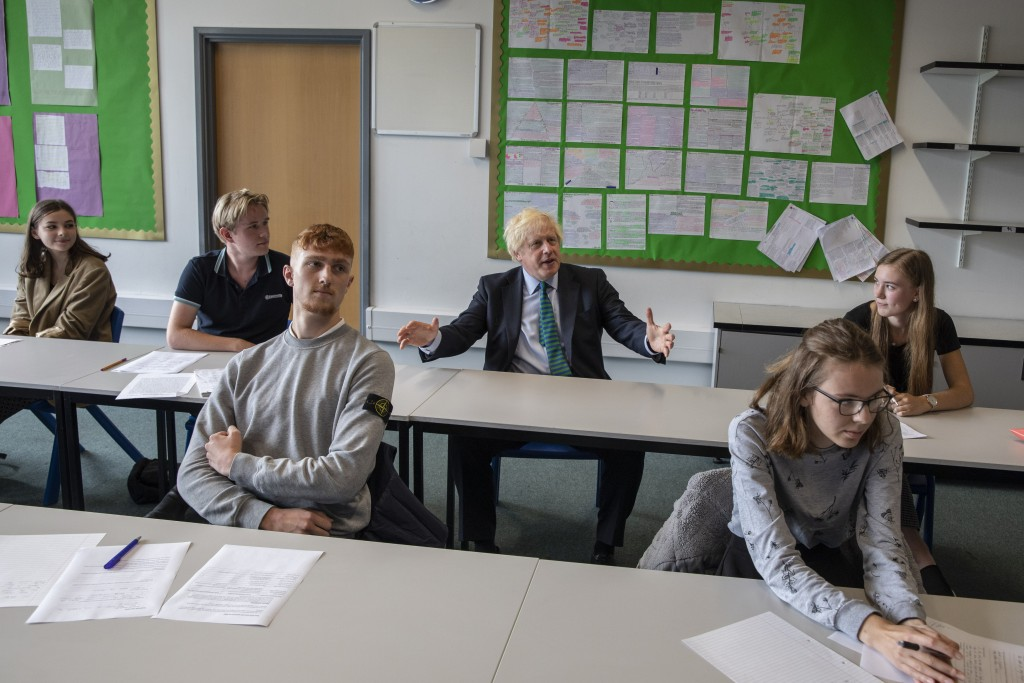 Britain's Prime Minister Boris Johnson sits in a Year 11 class , during a visit to Castle Rock school on the pupils' first day back, in Coalville, Eas...