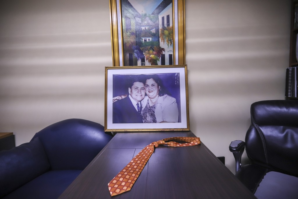The tie belonging to the late evangelical Pastor Ovidio Valladares sits on a table in his former office, along with a portrait of him and his wife Aur...