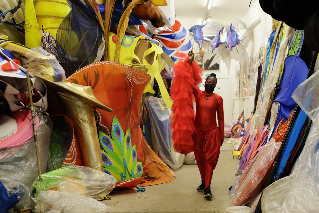 Ebony Beckford carries part of her costume as she gets ready for a prepping event ahead of this year's Notting Hill Carnival which will be held virtua...