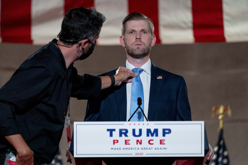 Eric Trump, the son of President Donald Trump, has his tie adjusted before taping his speech for the second day of the Republican National Convention ...