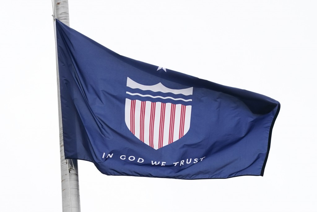 One of five final designs for the new Mississippi state flag flutters in the breeze, outside the Old Capitol Museum in Jackson, Miss., Aug. 25, 2020, ...