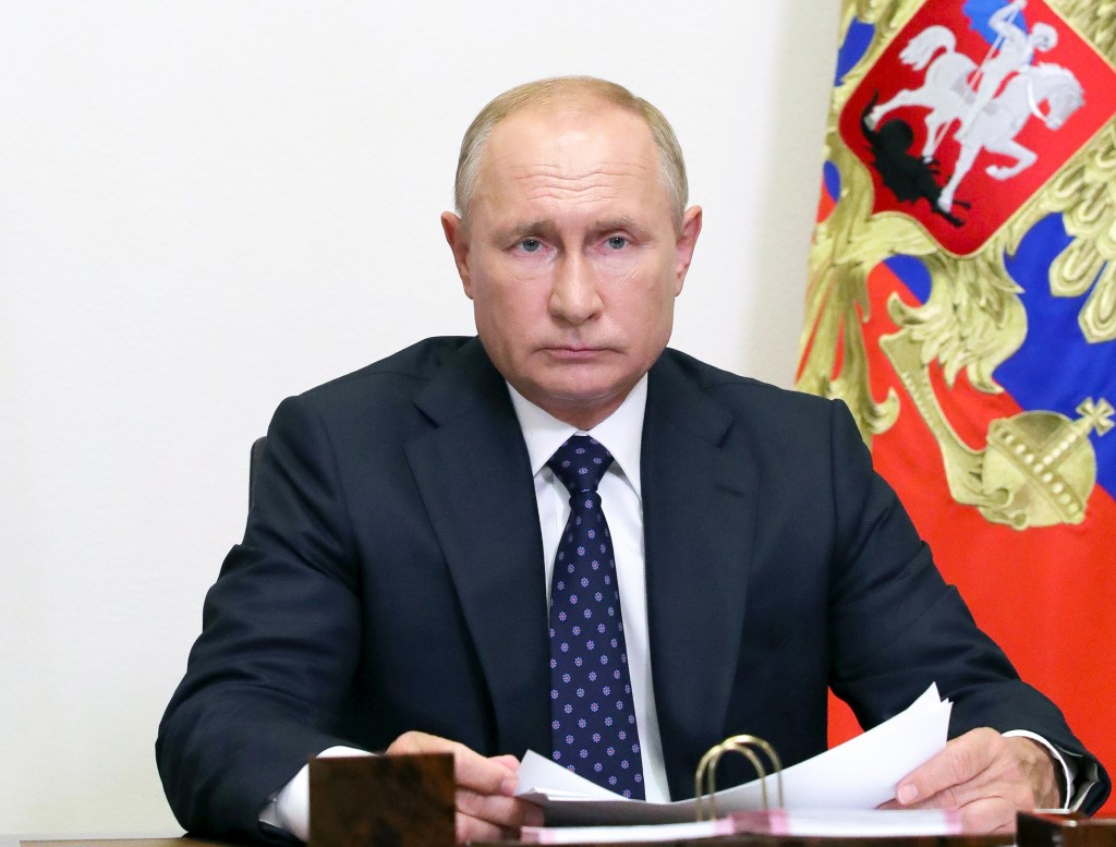 Russian President Vladimir Putin  takes part in a cabinet meeting at the Novo-Ogaryovo residence outside Moscow, Russia, Wednesday, Aug. 26, 2020. (Mi...