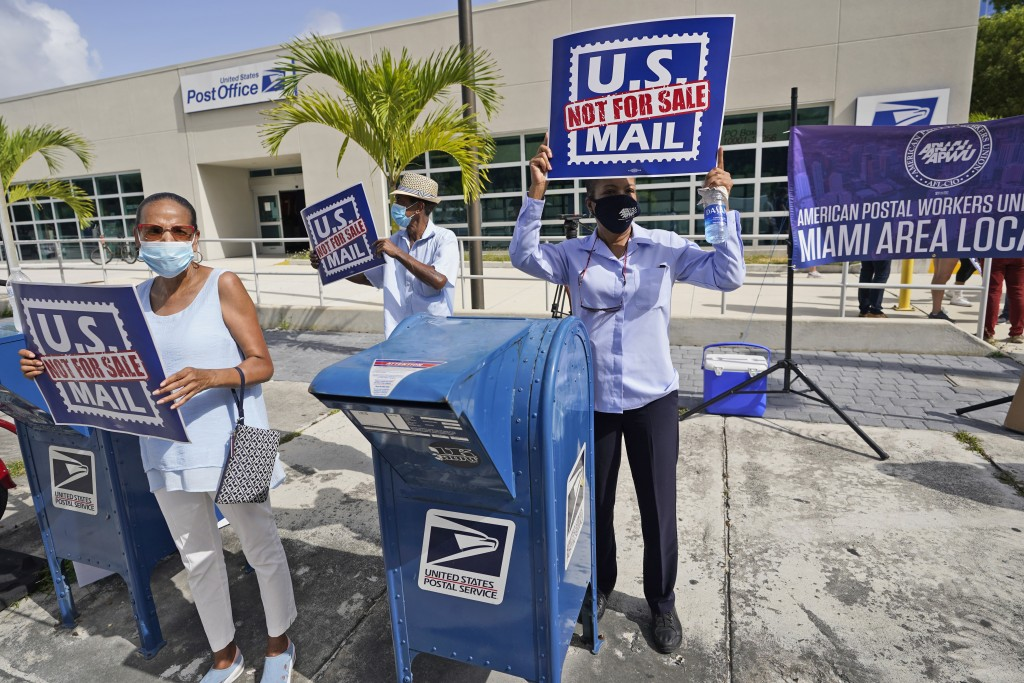 """Protesters demonstrate during a """"National Day of Action to Save the """"Peoples"""" Post Office!"""" outside the Flagler Station post office, Tuesday, Aug. 25,..."""