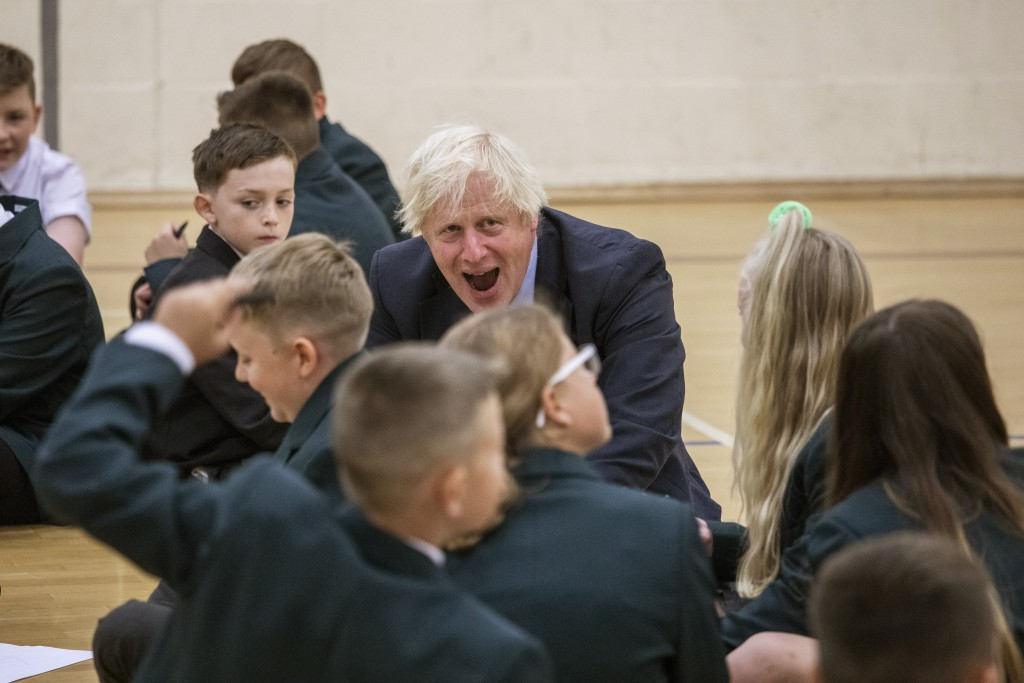 Britain's Prime Minister Boris Johnson reacts with children during a visit to Castle Rock school on the pupils' first day back, in Coalville, East Mid...