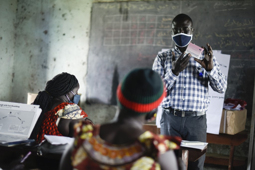 "An instructor discusses medical treatment with trainees, at a training session for community health workers conducted by the national NGO ""Health Link..."