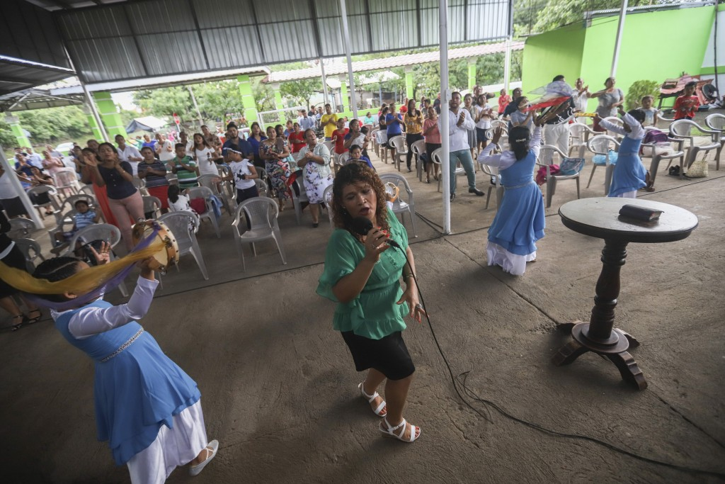 People attend a religious service at the Oasis of Peace evangelical church in Managua, Nicaragua, Sunday, Aug. 16, 2020. Evangelical churches have kep...