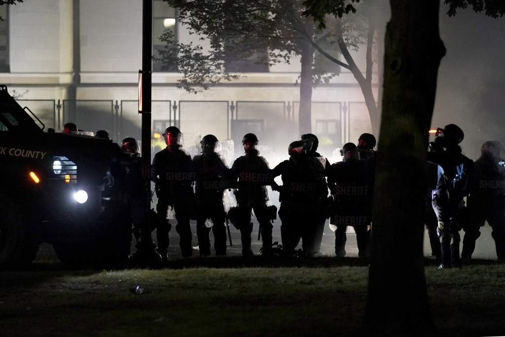 Law enforcement gather to address unrest Tuesday, Aug. 25, 2020 in Kenosha, Wis. Anger over the Sunday shooting of Jacob Blake, a Black man, by police...