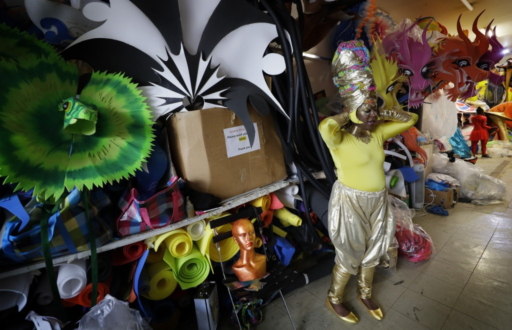 Carolyn Roberts-Griffith adjusts her costume for a prepping event ahead of this year's Notting Hill Carnival which will be held virtually, in London, ...