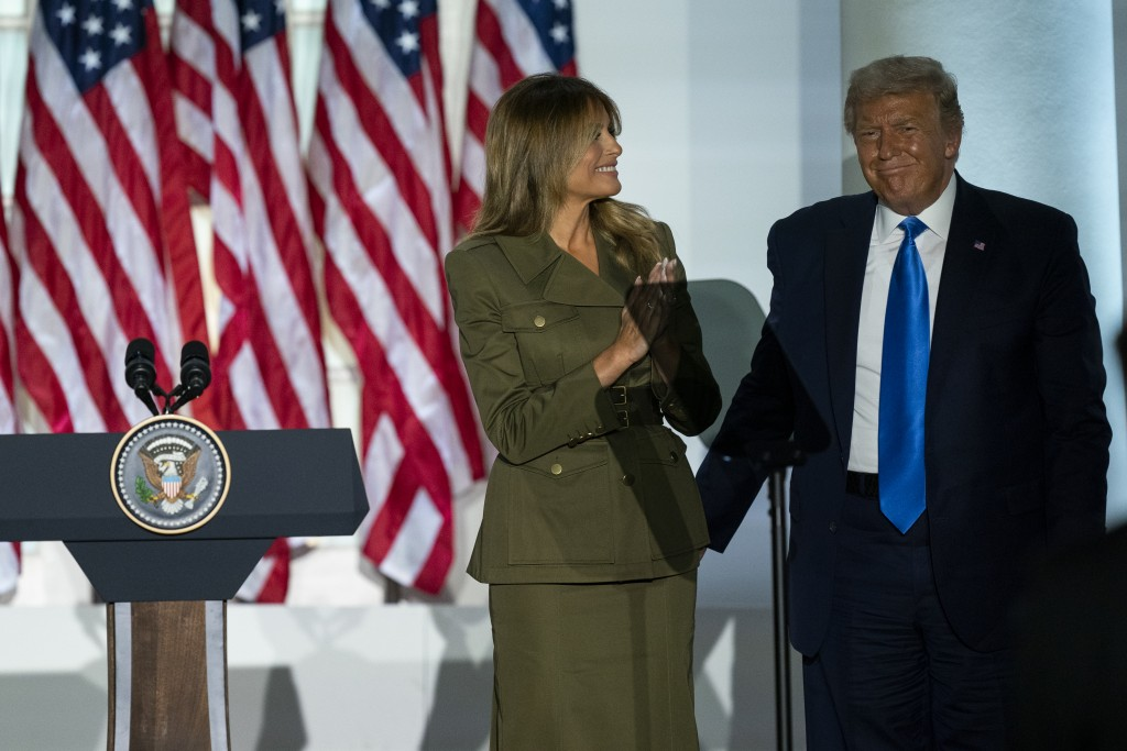 President Donald Trump joins first lady Melania Trump on stage after her speech to the 2020 Republican National Convention from the Rose Garden of the...