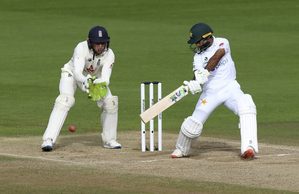 Pakistan's Asad Shafiq, right, bats during the fifth day of the third cricket Test match between England and Pakistan, at the Ageas Bowl in Southampto...