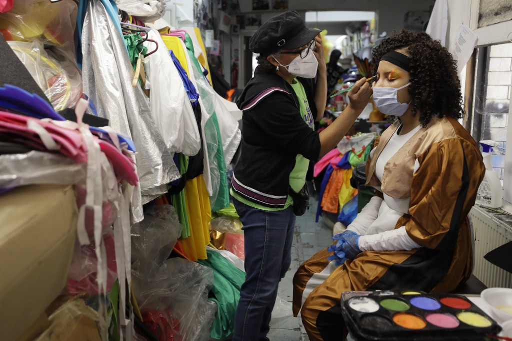 Clary Salandy one of the most noted designers of costumes for the Notting Hill Carnival applies costume makeup for a prepping event ahead of this year...