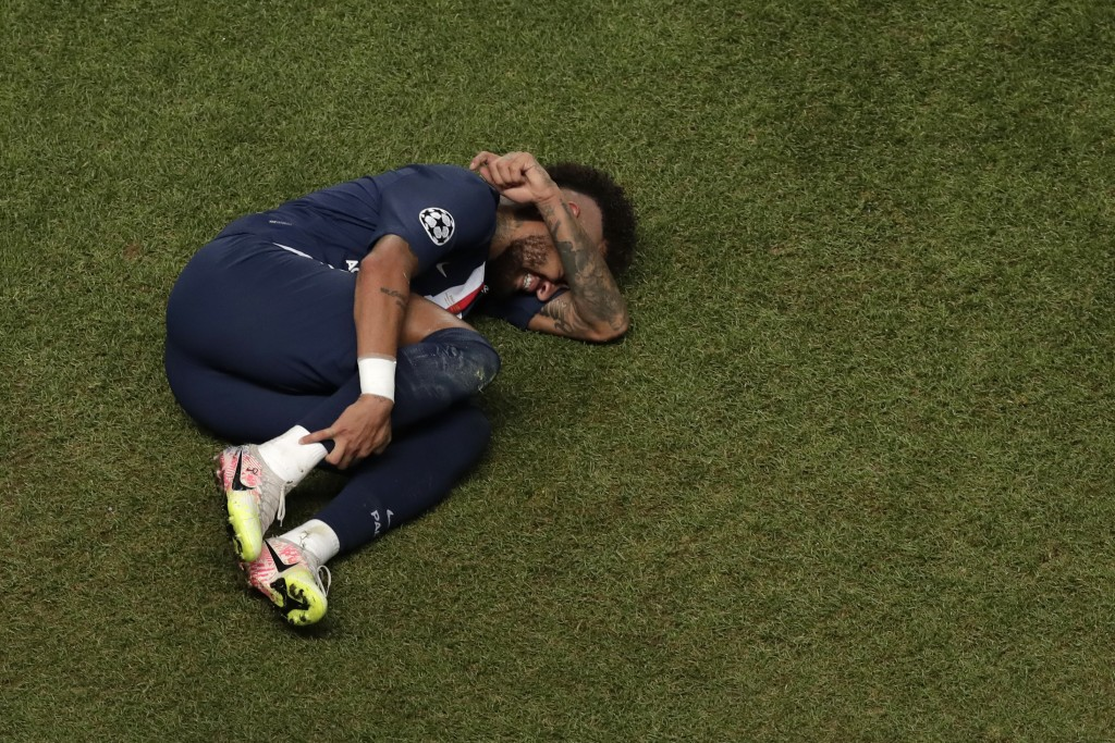 FILE - In this Sunday, Aug. 23, 2020 file photo, PSG's Neymar lies on the ground during the Champions League final soccer match between Paris Saint-Ge...