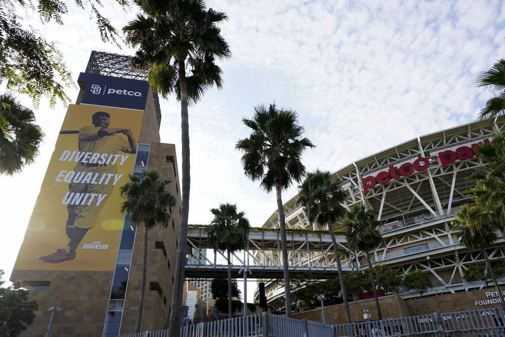 An image of baseball great Jackie Robinson hangs near Petco Park, where a baseball game between the San Diego Padres and the Seattle Mariners had been...